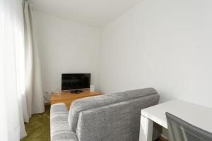A television and/or entertainment center at Apartments Stoll