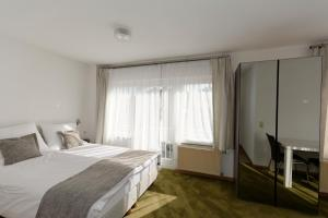 A bed or beds in a room at Apartments Stoll