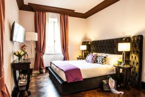 A bed or beds in a room at Grand Amore Hotel and Spa
