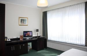 Телевизор и/или развлекательный центр в Hotel Plasky