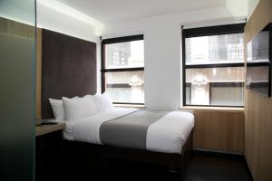 A bed or beds in a room at The Z Hotel Piccadilly