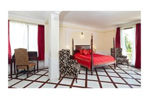 A bed or beds in a room at Dera Rawatsar - Heritage Hotel