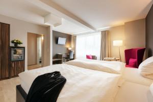 Ein Bett oder Betten in einem Zimmer der Unterkunft Hotel Hiemann - Superior