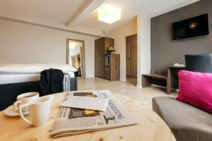 Ein Sitzbereich in der Unterkunft Hotel Hiemann - Superior