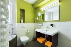 Ein Badezimmer in der Unterkunft Hotel Hiemann - Superior