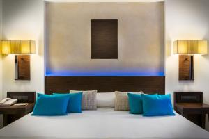 A bed or beds in a room at Elysium Resort & Spa
