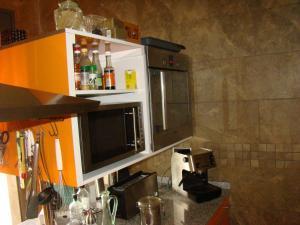 Una televisión o centro de entretenimiento en Can Clapa