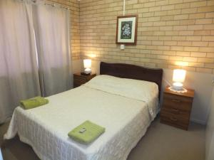 A bed or beds in a room at Sunrise Units
