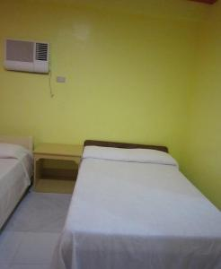 A bed or beds in a room at M&E Guesthouse