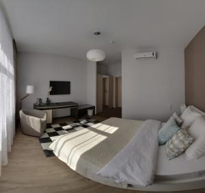 Кровать или кровати в номере Гостиница Силуэт