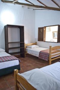 Кровать или кровати в номере Casa Aparicio Lopez