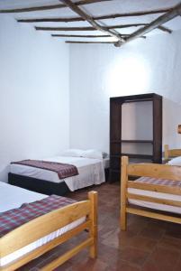 Двухъярусная кровать или двухъярусные кровати в номере Casa Aparicio Lopez
