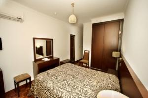 A bed or beds in a room at Hotel Mira Rio