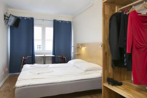 A bed or beds in a room at Hotel Copenhagen