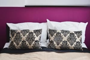 Łóżko lub łóżka w pokoju w obiekcie Hotel Pod Lwem