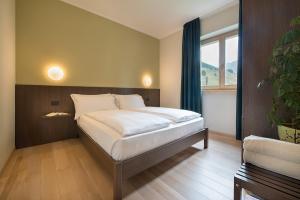 Postel nebo postele na pokoji v ubytování Central Rin