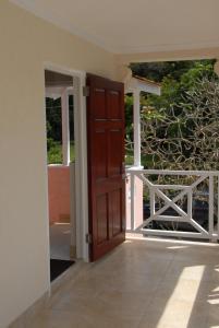A balcony or terrace at Sandy Bliss Condominiums