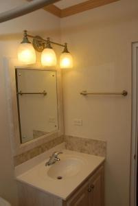 A bathroom at Sandy Bliss Condominiums
