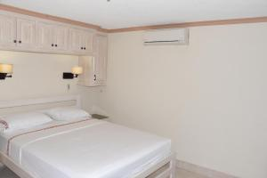 A bed or beds in a room at Sandy Bliss Condominiums