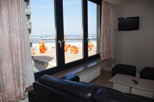 Coin salon dans l'établissement El Mirador Quality Stay - Apartments