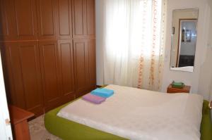 Letto o letti in una camera di Bellavista Romeo Apartments