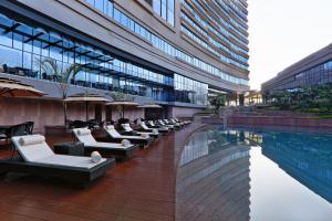 The swimming pool at or near Novotel Kolkata Hotel and Residences