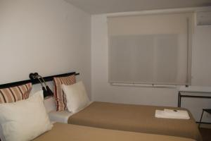 A bed or beds in a room at StayInn City - Évora