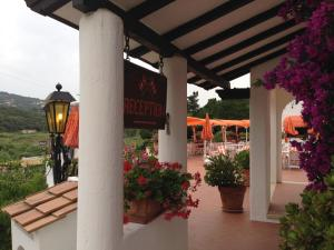 A porch or other outdoor area at Hotel Cala di Mola