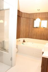 Um banheiro em Hotel Areias Brancas