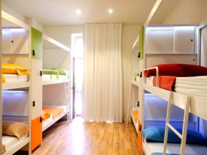 A bunk bed or bunk beds in a room at Urban Youth Hostel
