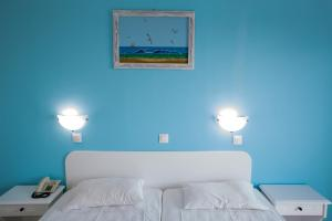A bed or beds in a room at Romantza Mare