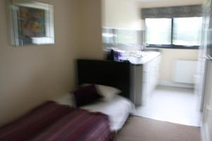 A bed or beds in a room at Colne Valley Bed & Breakfast