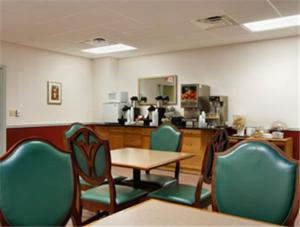A restaurant or other place to eat at Super 8 by Wyndham Dover
