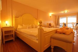 Ein Bett oder Betten in einem Zimmer der Unterkunft Panorama Hotel am Oberuckersee