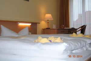 Ein Bett oder Betten in einem Zimmer der Unterkunft Hotel Stadt Spremberg