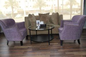 Uma área de estar em درر رامه للأجنحة الفندقية 8