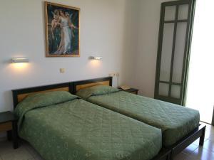 Ένα ή περισσότερα κρεβάτια σε δωμάτιο στο Ενοικιαζόμενα διαμερίσματα Νικόλας Βίλλας