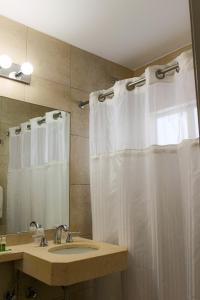 A bathroom at Collins Hotel