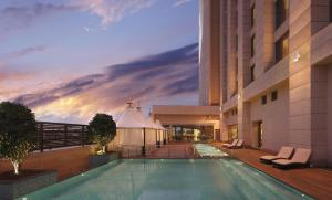 The swimming pool at or close to Hilton Jaipur