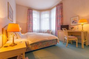 Ein Bett oder Betten in einem Zimmer der Unterkunft Hotel Residenz Joop