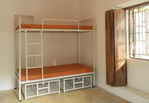 A bunk bed or bunk beds in a room at The Old Quarter Hostel