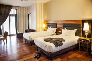 A bed or beds in a room at The Ranee Boutique Suites