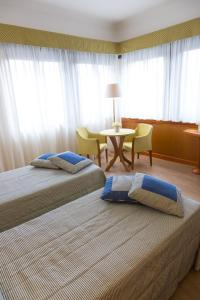 A bed or beds in a room at Hotel Futura Centro Congressi