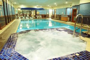 The swimming pool at or near Best Western Woodlands Hotel