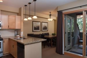 A kitchen or kitchenette at Lodges at Canmore