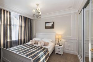 Кровать или кровати в номере Аглая Кортъярд Отель