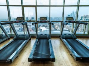 The fitness center and/or fitness facilities at First Central Hotel Suites