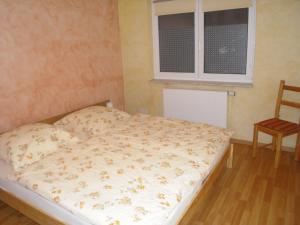 Ein Bett oder Betten in einem Zimmer der Unterkunft Ferienhaus Route 5