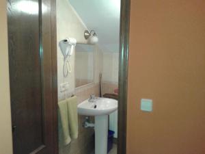 Un baño de Apartamentos Cobrana