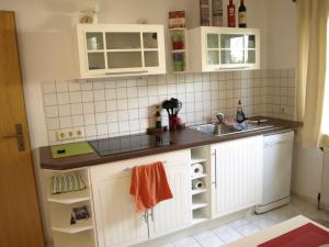 Кухня или мини-кухня в Ferienwohnung Thüringen